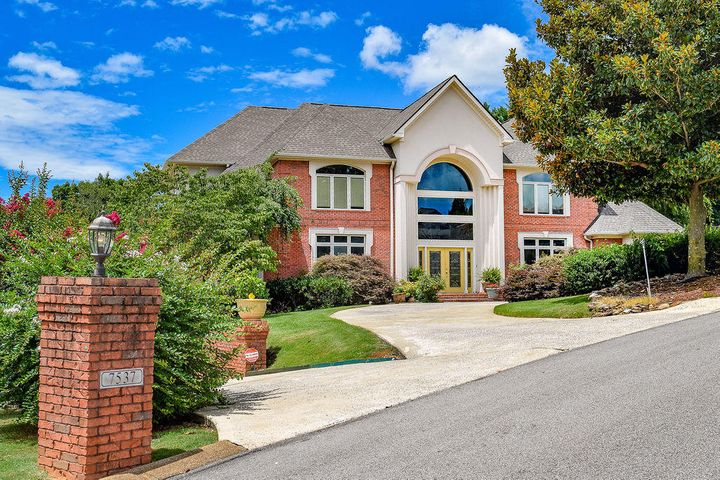 Come and view this exquisitely built custom home in Eagle Bluff! When you pull up to 7537 Tee Way Circle you will immediately notice the amount of detail that is included in this home! This home has a luxurious entrance way where you will notice a peaceful sitting area to your left and your private dining room on your right! The great room has amazing cathedral ceilings that opens into the custom kitchen with custom granite island! The custom master suite is on the first floor with a large master bathroom while the other 3 bedrooms are separated upstairs with their own private bathrooms. Enjoy the finished basement that has amazing room for entertainment! Don't forget the amazing back deck and custom designed landscaping in the back yard which includes an amazing waterfall and pond.