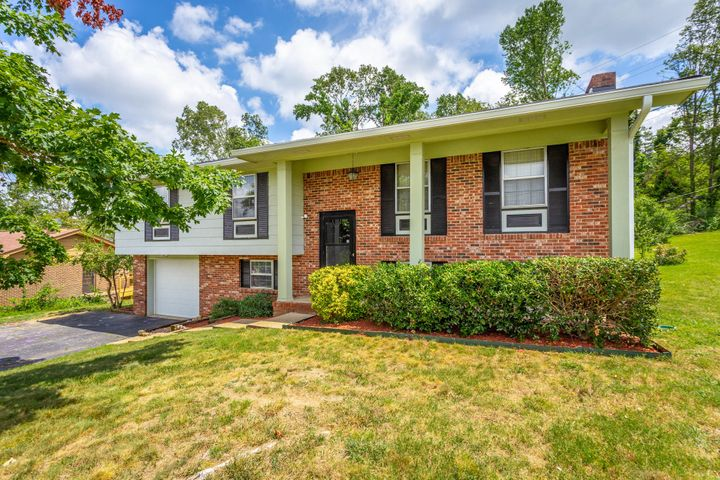 Location, Location, Location with great schools. Only minutes to Major shopping area, hospitals, restaurants, VW, Amazon and I-75.  In County. Great for first time home buyer or investor.  NEW ROOF IN 2020, NEW GUTTER IN 2020, INTERIOR PAINT IN 2020,  WATER HEATER IN 2019, INSULATED GARAGE DOOR  IN 2018 AND SELLER PROVIDES HOME WARRANTY.  Spacious split foyer in cul-de-sac offers 4 bedrooms, 2.5 baths, living room, dining room, eat in kitchen (refrigerator remain with the house), in walkout/daylight basement : bedroom, den with wood burning fireplace, laundry room with cabinets ( washer and dryer remains), half bathroom and work area/storage.  Newer glass sliding doors open on huge deck over looking private, wooded back yard. Replaced Septic Fill Line. A MUST SEE!!!