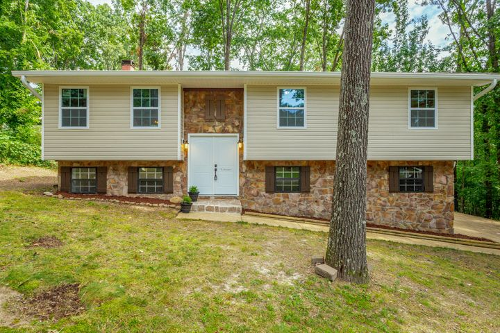 Come see this great East Brainerd home zoned for Westview and East Hamilton schools. County Taxes! This wonderful home is move-in ready! It's just waiting on your furniture! New interior paint, new luxury vinyl plank throughout, new windows, new vinyl siding and gutters, new roof in 2019, new hot water heater, new stove, dishwasher and new countertops & cabinet refinish and shower/tub refinish plus new garage doors! This 3 bedroom / 2 .5 bath home is perfect for first-time home buyers or a growing family.  Enjoy the large living room and separate dining room upstairs and the cozy family room with wood-burning fireplace downstairs. Grill and entertain to your heart's content on the large deck directly off the kitchen which leads to a spacious and fenced backyard - great for children and/or pets or more outdoor fun. Laundry room/ half bath is conveniently located downstairs (also check out the cedar-lined closet). Large two-car garage is a nice bonus. Location! Convenience! Schools! Space! Move-In Ready! This home checks all the boxes!