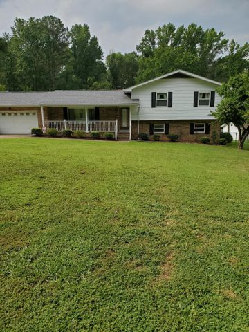 This is a wonderful home located in East Brainerd on a huge lot that is level. Large home features a new roof as of two weeks ago. This house has an eat in kitchen, separate dining room and living room, a den with a fireplace, and laundry room complete the first floor. Three bedrooms and two baths complete the upper level. Basement, living room, and den have lots of storage (could be possible separate living quarters with private entrance). Screened in porch overlooks large backyard with room for garden.