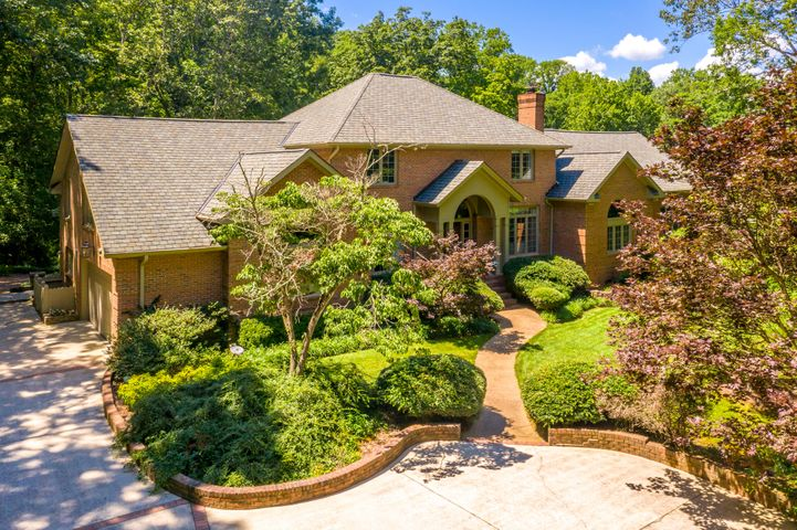 One of a Kind Private Estate Property with a second to none location in Walden on Signal Mountain. Home sits on 11.79 private acres and includes two fenced pastures, a barn, in-ground pool, a patio and is bordered by hiking trails, yet is close to the Signal Mountain town center and downtown.  Truly a retreat, the home features a spacious master bedroom on the main floor with an oversized master closet complete with built-ins by Chattanooga Closet Company, a bar area off the den features drawer refrigerators, an ice maker, wine cooler and a locking liquor cabinet. Upstairs are three good sized bedrooms each with their own bath and a play/family room. The basement has a playroom, workout/gym area and a 1/2 bath. The laundry/mud room on the main floor includes a sink, and bath with a shower.