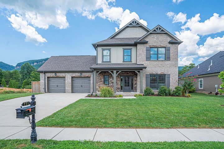 JUST LISTED...THE CANYONS! ***OPEN SUNDAY 8/16,2-4PM ***Priced for quick sale! 1 Year NEW and Move in Ready -- Loaded with Upgrades! CLOSE TO DOWNTOWN & HIXSON BUT YOU PAY ONLY COUNTY TAXES!!!!!  Gorgeous floor plan-loaded with upgrades.  The tour begins with A+ curb appeal. This exterior has the perfect blend of stone, brick, plank and architectural shingles plus an irrigation system to keep the lawn and gardens pristine. Guests are greeted by such a welcoming covered porch. You'll enjoy decorating it for the various seasons! As you walk through the front door, you are immediately impressed with the Blue Ribbon interior beginning with  the rich wide plank hardwood that seamlessly runs through room to room throughout the full main level.  The foyer is spacious and has a coat closet. The powder room is neatly tucked away off the foyer as well as the mud room with bench, hooks and cubbies. There is a large closet in this room as well as access to the 2 car garage with extra room for storage items. The large, formal dining room is on the front of the home and is adorned with a gorgeous coffered ceiling and trimwork.  An alcove that would make the perfect butler's pantry connects the dining room to the kitchen.  Built-in cabinets or a hutch would be perfectly suited to this space. The oversized great room is full of windows and streaming daylight, The gas fireplace, flanked by mission windows takes center stage and the surround is a beautiful rough tile.  Entertain to the max with this completely open floor plan combining the great room, kitchen and breakfast room.  The upgraded granite and backsplash are the perfect compliment to the crisp white cabinetry with soft close, dovetailed drawers. The extended island is great for breakfast on the run or as a serving bar for entertaining.  There is a perfect spot for a coffee bar on the counter adjacent to the island. The family-sized breakfast room looks out over the private backyard. A french door between the great room and breakfast room opens to a patio and a completely fenced backyard with KNOCK YOUR SOCKS OFF VIEWS OF SIGNAL MOUNTAIN!  Back inside,the gorgeous wrap around hardwood staircase leads to a large flat ceiling bonus room.  The hall bath with granite counters services the secondary bedrooms.  A good-sized laundry room is home here so you don't have to carry laundry up or down!  The linen closet is nearby on the hallway as well as pull down attic steps for additional storage needs. The secondary bedrooms are such a generous size - one with a huge walk-in closet and the other with a large double closet.  Last but not least is the well appointed king-size master suite with double tray ceiling, large windows and plenty of wall space for large furniture pieces.  It is complimented by a beautiful master bath with oversized tile shower, private commode room and extra wide double sink vanity with a ton of storage, granite counters and beautiful separate mirrors and lighting.  There is so much room elongated walk-in master closet that you'll never be tight on space.  Never a day goes by where you won't see children out playing and neighbors joggine or strolling.  The pool is a great place to get to know the neighbors. The littles will love the adjoining playground and there is a boulder climb park as well. This peaceful, friendly neighborhood is known for its pride of ownership and sought after because of its fantastic location.  Shopping, dining, parks, marinas, and all that our wonderful downtown Chattanooga has to offer are all right at your fingertips! You are investing in not only a home, but a lifestyle that has brought much happiness and generous appreciation for its homeowners.  This meticulous bells and whistles home is no exception so don't delay in scheduling your private tour!