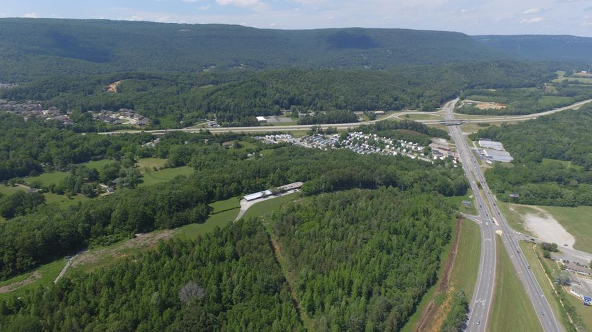 Development opportunity in central business district of Hixson. Over 21+/- acres of scenic hilltop offering northern views of the Tennessee Valley and surrounding mountains. Easy access to all Hixson shopping and retail along highway TN153. Nearby US 27 is only about a 10 minute drive to the Chattanooga Riverfront.