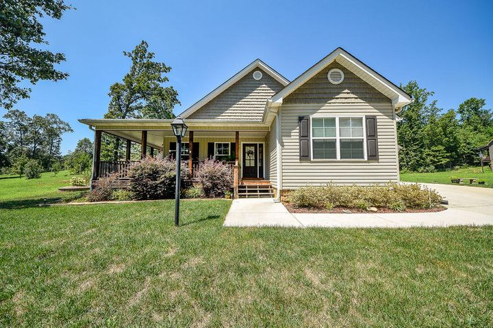 Built in 2014 this home is all one level accept for the large finished bonus room upstairs. Take a look at the beautiful landscaping and this fenced in back yard. You will love having your morning coffee on the semi wrap around porch over looking the little field where the bunnies like to play. I can wait to take you on a tour of this 3+ bedroom/3 full bath home. i just think this is going to be the last one you need to see.