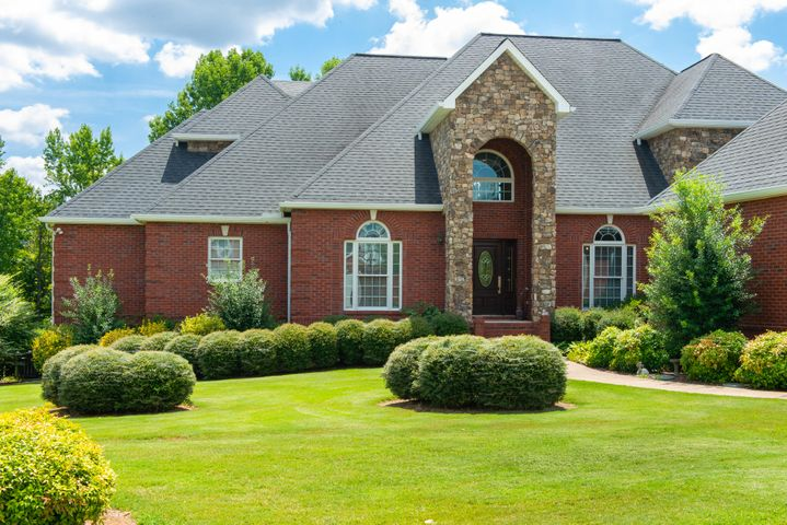 Want to live on the lake? Look no further! Beautiful 6 bedroom, 4.5 bath home located near everything in Ooltewah.  Go boating or fishing off of your private dock or swim in your private inground heated salt water swimming pool.  See the photo of the recent updates.  Walk in the  front door and be greeted by sunlight through the windows in the living room.  The updated private office and formal dining room are just off of the foyer. Move into the updated kitchen on the left and notice the new appliances, the large butler's pantry, and the large laundry room.  To the right of the living area is the large owner's suite which includes an en suite with separate vanities, a new tiled shower, and 3 over sized closets (one is a room of it's own).  3 bedrooms and 2 full baths are upstairs. Downstairs would make a perfect in-law suite or swimming party hangout as it features a family/recreation room with a fireplace, 2 bedrooms, a bonus room and a 2nd kitchen.  There is a utility garage located on this level with extra room for storage.  A three car garage on the main level and the stationary dock out of your back door make this the perfect home.  Schedule your private tour today!