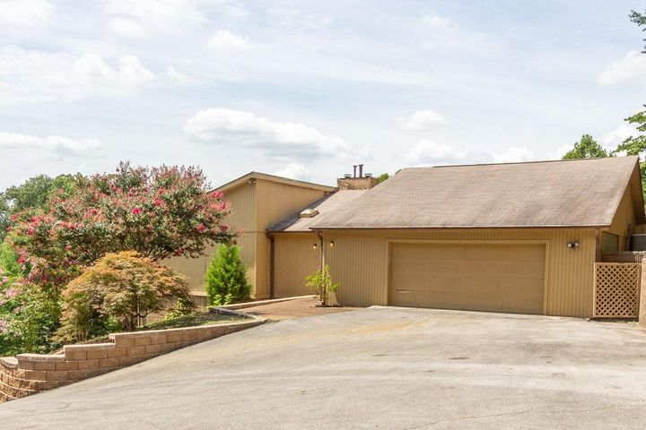 This home is private and hidden from neighbors. The lot is big enough to consider building another home. Just minutes from Hwy 58 and 153. This large house is perfect for the person that can make the needed updates. A pre-listing inspection was done July 20, 2020. It is available from the listing agent upon request. The main floor has a spacious kitchen (just off the garage), master bedroom and bath and 2 additional bedrooms with a Jack and Jill bathroom. Balcony overlooking the yard. There is a living room with a fire place and a dinning room.Downstairs is a large den with fireplace, a bedroom with full bath, and a large bonus room.Tons of natural light with glass doors serving as windows for all bedrooms. 2 car garage is over sized for added work space. Utility buildi