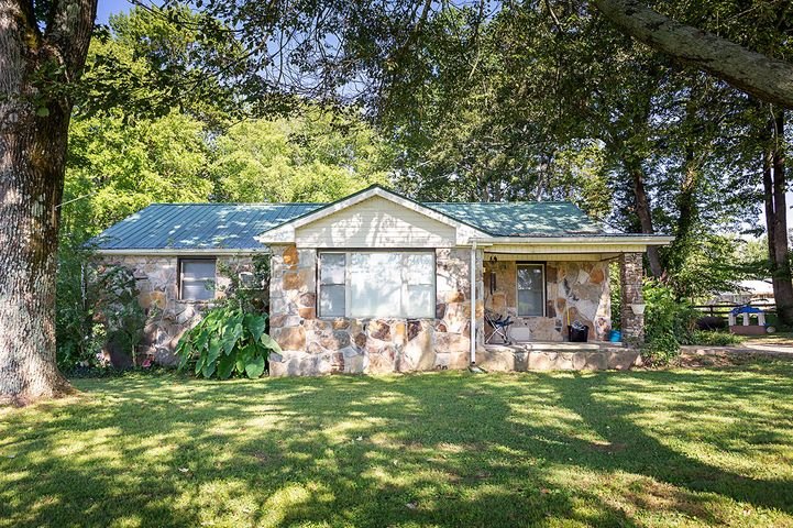 A farm for your family. Return to a simpler way of life. Resting on almost 13 acres, this delightful stove cottage offers 3 bedrooms, 1 bath, a fireplace, new flooring, new paint, new windows, a new HVAC installed in 2017, a metal roof, and a 2 car carport. Step outside to find 12.5 level acres with 2 stocked ponds, a workshop with separate electricity and plumbed for a bathroom with septic system, and a 10x20 storage building. This farm is on city water with a well that can be used to water your garden. There is over 400 feet of road frontage, and can be developed or bring your animals. The property is partially fenced. Don't miss this one for $269,900! Call today!