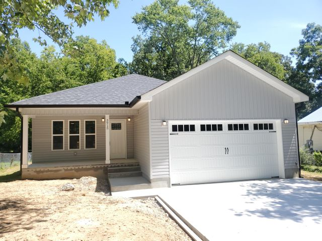 The final touches are being made on this newly built 1,746 square foot in the heart of East Ridge, located down the road from East Ridge Elementary, Middle, and High School. Situated approximately 15 minutes from downtown Chattanooga and 20 minutes from the Hamilton Place area. This home features an open floor plan with 3 bedrooms, 2 bathrooms, and an over-sized  2-car garage. The home includes hardwood floors, granite counter tops, and tile showers. The general contractor has been working in the Chattanooga area for over 15 years and specializes in custom work, so rest assured that this home was constructed with detail and care.  Yard will be sodded and there will be landscaping by the entry.