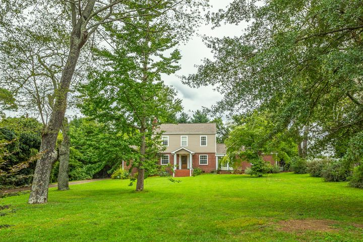 Amazing gardens, beautiful lawn, and great house with inground pool.  This home has hardwood, slate and tile flooring. It also features a magnificent sun room that is open to the kitchen with solid surface counters that overlooks the beautiful garden.  The family room is off the kitchen and includes a wood-burning fireplace.  There is unbelievable privacy, if this is enticing to you, make your appointment today.