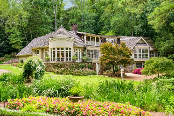 *Currently under contract with a 48 Hour Right of Refusal* Rare private retreat on nearly 6 quiet acres. Opulent, secluded and remarkably detailed, this lush home is an architectural masterpiece. The grounds alone are worth the price with meticulously landscaped pathways, stone bridges, flowers and foliage hand selected to showcase each season. Enjoy your morning coffee on the patio dock overlooking an exquisite private lake stocked with fish, frogs and turtles. If houses had names, this one would be Serenity. A complete irrigation system keeps the lake full, the landscaping watered and the waterfalls at exactly the right level. The house itself feels like waking up on vacation in bed and breakfast in the Highlands combining old world charm with modern conveniences. The entire property is the masterpiece design of famed architect Norman Askins, designer Dan Carithers and built by George Getter.  These two helped to create a property seemingly unparalleled in this area.  Where else can you enjoy a sprawling waterfall through your kitchen bay window while you cook?  The home features the best of everything including a Waterford chandelier, heated bathroom marble floor, a master suite with his and hers bathrooms and closets, custom ornamental iron work, waterfall designs by Ron Salzer, many custom built-ins, incredible custom woodwork throughout, 2 large fireplaces and so much more to list.  If you want to experience resort style living, call Adam Hammond at 423-464-1812 to set up your private tour.