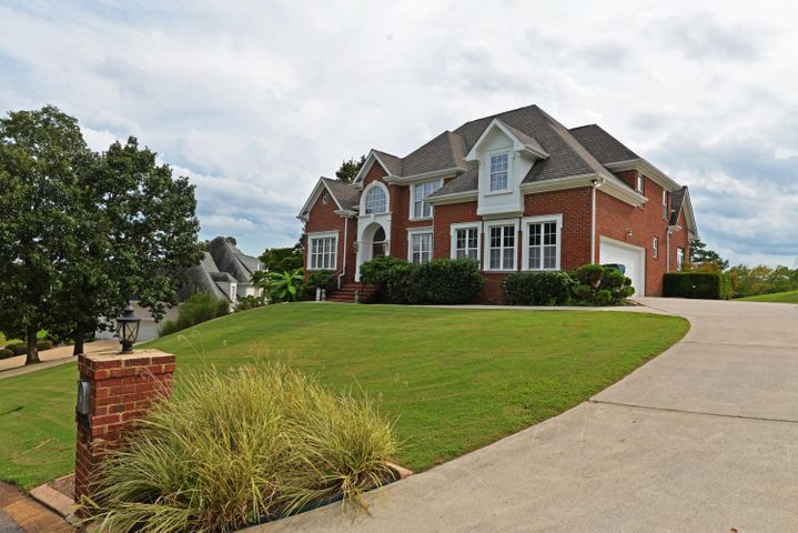 Custom built one-owner home in the established Eagle Bluff neighborhood, centrally located in the Hwy 58 area close to the Airport, Hixson, the Hamilton Place shopping district and even downtown Chattanooga. This stately home sits perched on a hill with scenic distant views of the mountains and boasts a versatile floor plan which includes an open floor plan, wonderful arches and specialty ceilings, the master on the main, spacious bedrooms, a daylight basement with a 3rd garage bay and secondary driveway.  The home features a double door entry with a 2 story foyer with multiple arches to the formal dining room. A home office was once used as a home salon and has a sink that could easily be converted to a wet bar. The great room also has a 2 story ceiling and see-through gas fireplace to the keeping room which is open to the breakfast area and kitchen. The latter space has stone tile flooring, French doors to the rear expansive deck and access to the adjoining laundry room and pantry. The kitchen has granite tile countertops, a center island, stainless steel appliances and access to the main level garage for easy loading and unloading. A half bath is located in the hall just off the great room and master suite. The master bedroom also has French doors to the rear deck and the master bath which has travertine tile floor and dual vanity, a jetted tub, separate shower and walk-in closet with organizer system. The upper level has a central landing area that overlooks the great room, 2 bedrooms adjoined by a J & J bath, another bedroom that has shared access to a hall bath and another space that consists of 2 bonus rooms connected via French doors that could be used as sleeping quarters and a sitting room or an enormous walk-in closet if desired. The walk-out basement has a large family room with access to the 3rd bay and separate door to the second driveway, a rec room with French doors to the covered patio, a full bath and a partially finished exercise room. Simply a great opportunity for the buyer looking for a spacious home with plenty of living and entertaining space for all, so please call for more information and your private showing today. Information is deemed reliable but not guaranteed. Buyer to verify any and all information they deem important.
