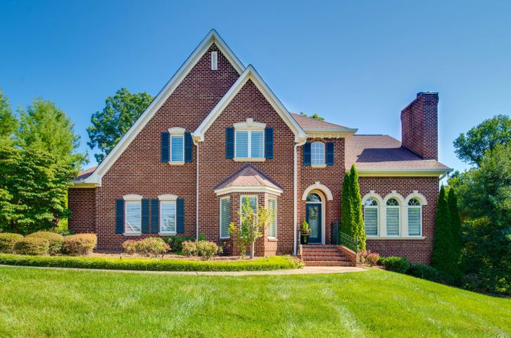 It will be hard to find a more beautiful all brick home with 1.3 acres, idyllic manicured patio and gardens, and ground-level, two-bedroom guest cottage in beautiful Walden on Signal Mountain! Take a quick walk to the brow and enjoy the views. The attached photos and video walk-through speak volumes about this home , where words alone are not sufficient! NOTE: The guest cottage virtual tour can be accessed by clicking on the small circle with blue either in the kitchen photo or the screened porch photo. Then use the  ''click here'' link.MAIN HOUSE:  This 5 bedroom, 4.5 half bath home is immaculate and well-loved by its owners.  The stately frontage, architectural features and fine finishes create an elegant but warm atmosphere for enjoyable at-home living entertaining friends & family. The first level has everything you would need for one-level living, and the remaining levels are perfect for family members to spread out and have their own space. The main level master bedroom is gracious and is a private retreat from the world outside. The ensuite master bath is spacious and includes the well-designed master bedroom closet. The 3 second-level bedrooms are large.  One bedroom has a private attached bath, and the other 2 bedrooms are served with a Jack and Jill bath. Enjoy the rec room/media room upstairs as well.  The  two-story foyer is classically elegant, and is flanked by the living room on one side with its gas log fireplace and the spacious dining room on the other side. The well appointed kitchen has hardwood floors,  cherry cabinets, instant hot water dispenser,  granite counters, stainless appliances and includes a french door counter depth refrigerator.  The two car garage is a clean and well organized space, and an additional stone paver driveway extension provides extra parking. Enter the magical screened porch overlooking the gardens. The screened porch flows to the deck and into beautifully landscaped backyard with patio, gorgeous mature trees, flowering bushes and trickling fountain, which are irrigated by  (free) well water! Think light and bright when you enter the walk-out finished lower level with bedroom space, full bath, huge closet, and additional office or flex space, with lovely windows. French doors open to a spacious and level side yard ready for family or neighborhood games.  This yard could also be converted to an extra large garden or swimming pool.  The yard is flanked by a vintage outdoor stone fireplace. The owners have created a peaceful and beautiful outdoor haven with lush foliage and extensive landscaping  abounding in the front , sides and especially the backyard.The stone paver patio and walkway, scores of flowering shrubs and bushes, and a tiered water fountain between the main house and the guest cottage provide privacy and tranquility between the two homes, with a charming atmosphere for both.  RENOVATED GUEST COTTAGE WITH ADDITIONAL 900 SQUARE FEET:(not listed in the 5023 SF)  Welcome to this charming and restful backyard home that can house guests or  residents, including aging parents, boomerang children, or renters. This adorable get-away is also perfect for a homeschool, a virtual workspace, or a home based business...use your imagination! And, IT IS FURNISHED!  (with the exception of a few pieces)  You will feel like you are in a storybook when you step onto the front porch and enter the light-filled space with original heart pine floors that blend seamlessly with the  crisp fresh interior.  The cottage has two bedrooms, kitchen with bar seating, full bath with double vanity and tiled shower, rear deck and its own septic system.  The natural light is inviting through the lovely windows with picturesque views outside.  The full kitchen has all stainless appliances, granite counters and lovely white  cabinets. Walk out to the back deck from the kitchen and enjoy the peace and quiet. The laundry closet accommodates a full-sized washer and dryer, and a smaller stacked unit is provided.  It is truly a place you won't want to leave! (except to go back to the big house)
