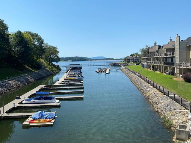 BEAUTIFUL LAKE Front VIEW!  One Level condo- middle unit with a 2 car garage. All rooms have amazing lake views. MUST SEE!You can add your special touches to this lake view property.  Boat slip -26 ft is included in the listing .Sold '' as is''