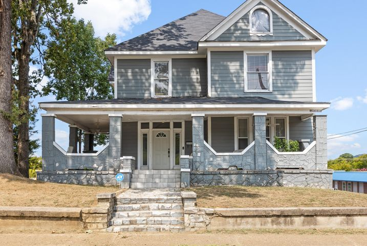 Invest in a piece of history with this unique home built in 1910, located in the heart of the popular Highland Park. Not only does this home sit in the perfect location, just minutes from downtown Chattanooga, at almost 2,700 square feet it is a rare find for the area. Situated on one of the largest lots around, 1515 Duncan Ave. is a great home for a growing family or someone searching for the perfect investment property. When entering, you will be greeted by the original staircase with much character, setting the theme for the rest of the home. To your left, is where you will find the open living/dining area which boasts one of four gorgeous fireplaces all also original to the home.  This is the perfect space for entertaining! The spacious master bedroom with en-suite is located just off of the living area. Making your way into the kitchen, you will pass by a half-bathroom & large laundry room. The hallway opens up into the kitchen featuring wonderful natural light, exposed brick, a center island & a pantry with custom shelves for storage. The four guest bedrooms & shared bath are located just upstairs, offering your guests the perfect amount of privacy. With a little TLC, this home has the potential to become a buyer's dream! **Property sold as is**