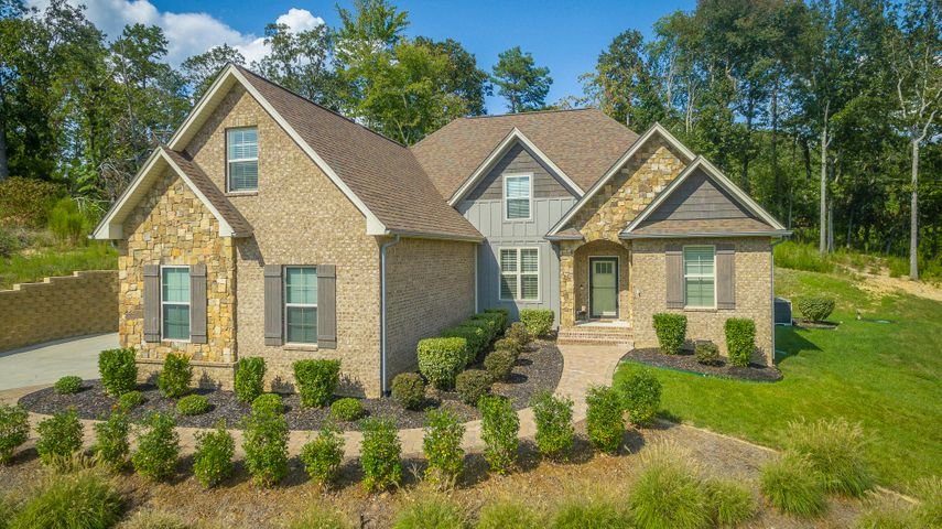 Welcome to Riverbay Estates! Better than NEW -This beautiful and meticulously maintained home offers an open floor plan with upgraded features. Less than THREE years old, these owners have treated this home will unbelievable love and care. Situated on a .75 acre lot with a private back yard setting, and stunning views from the front porch. From the moment you enter the front door, you feel AT HOME. Mostly single level, the main floor includes a spacious living room with a gas fireplace, a desirable dining room with lots of natural sunlight, and a cozy breakfast nook. The kitchen is a chef's dream. With granite countertops, custom backsplash, expansive cabinets, gas cooking, pot filler faucet and long bar for quick breakfasts or a place to sit and chat while dinner is being prepared. Gorgeous main-level master suite offers a luxurious bathroom with deep soaking tub, large glass shower, separate vanities and a walk-in closet with custom built-in shelving. Need a fourth bedroom or home theater? Convert the large bonus room into the space you desire!  Riverbay Estates is a beautiful community that offers a wonderful family environment for you to enjoy. Convenient to area schools, grocery choices, the Chattanooga Airport, Volkswagen and only 25 minutes from Downtown Chattanooga. A stone's throw from Chickamauga Lake - Boat ramp within one mile from neighborhood. If you are searching for a home in Chattanooga, then be sure to schedule your tour of 5118 Abigail Lane today!