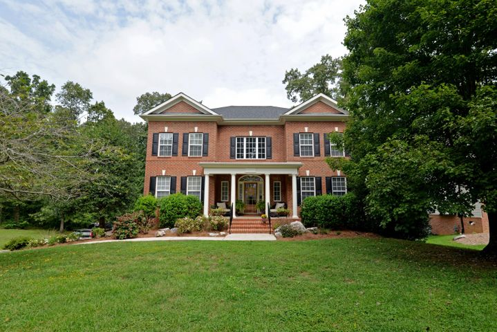 Stately brick and Hardie, 4 bedroom, 3.5 bath home with a partially finished basement on a .64 +/ acre lot in the established Eagle Creek neighborhood of Signal Mountain. This lovely home has wonderful curb appeal with its covered front porch and mature landscaping, and is partially wooded in back providing coveted privacy. The main floor boasts hardwoods throughout with a spacious foyer that opens to the dining room on the left and the living room on the right. A large family room with a wood burning fireplace with a gas starter and access to the rear partially covered deck  opens to the kitchen and breakfast area. The kitchen has a center island, granite countertops, a downdraft cook top and wall oven, a double door pantry and built-in desk area and is open to the breakfast area. The area has pocket doors to a nice office or study. The laundry room and powder room round out this level. The sleeping quarters are on the second floor, including the master bedroom which has a trey ceiling, French doors to a private covered balcony, as well as the master bath with separate vanities, jetted tub, separate shower with tile surround and a large walk-in closet. There is also a guest bedroom suite with a private bath and 2 additional bedrooms adjoined by a J & J bath with separate vanities and walk-in closets. The daylight basement has a family or media room with French doors to the rear patio and back yard, great storage and access to the large double garage. The back yard also has a patio area that overlooks a wet weather creek that runs behind the property. All of this, and it is located in a one street, cul-de-sac neighborhood close to the award winning Signal Mountain Schools, so please call for more information and to schedule your private showing today. Information is deemed reliable but not guaranteed. Buyer to verify any and all information they deem important.
