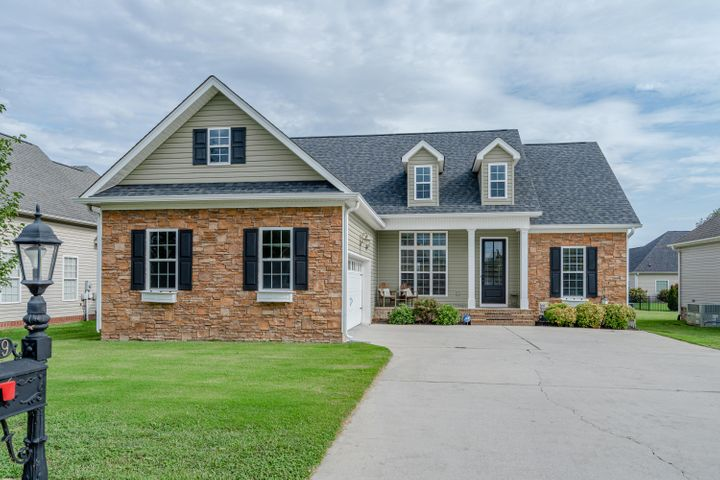 Welcome to Georgetown Landing in the 37363 hot zip code of Ooltawah. This was a custom built home with so many extras. One level living with a split plan. Private master bedroom and beautiful bath tucked away for privacy with 2 additional bedrooms on the opposite side of the home with an additional full bath. Large entry with a gorgeous front door to great family and guests. Living room with vaulted ceiling amazingly trimmed out with crown molding to awe everyone who walks through the door. Formal dining, breakfast room and open kitchen for many family dinners. The living-room opens onto a over-sized covered deck for plenty of cozy evenings in the large backyard. Front door key-less entry. Access your smart home with a cell phone. Front door , garage and air unit are all Wifi. This community features a swimming pool and is perfect for evening walks and meeting neighbors. Just minutes to I-75 and back to Ooltewah for shopping and dining. Cambridge Square is 5 minutes away. Location is perfect and in a pristine community. This community is in a much desired school zone. Your new home is a call away.