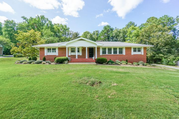You'll love this classic mid-century brick rancher with a large finished basement. It sits atop a lovely, gently sloping hill on a huge 1.39 acre lot. The dream kitchen is designed to please the most discriminating chef. It has custom cherry cabinets, granite countertops, a huge work island, Thermador built-in refrigerator and freezer columns, Thermador 6-burner gas cooktop, Thermador double convection wall ovens and a Bosch dishwasher! The main floor has all solid hardwood floors and the basement has attractive and durable engineered hardwood. This roomy house just needs a new family to make it their own! Located in desirable Harris Hills the neighborhood is family friendly, private, and just minutes from every convenience. Don't wait! Make your appointment today to see this awesome house