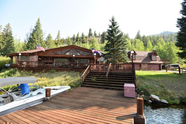 Lakefront with few steps, home with large attached garage.