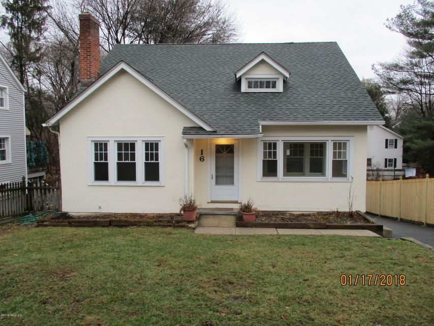 This charming stucco cottage is close to Binney Park, Perrot Library, the railroad station and the village.  The house offers a large living room with fireplace, solarium, dining room, kitchen, two bedrooms and one bath on the first floor.  On the second floor, there are two more bedrooms and another bath.  There is a large family room on the lower level featuring a potbelly stove, as well as a one-car garage and laundry room.