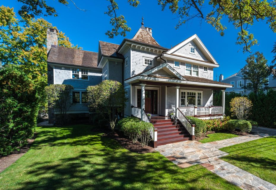 An inviting porch welcomes you into this 5 bed, 3.5 bath home featuring 9ft ceilings, beautiful millwork, and vaulted beamed ceilings throughout. The office, living, and dining rms graciously flow into a spacious kitchen family rm with eating area. Gourmet kitchen with custom cabinetry, stone countertops, Wolf/SubZero appliances. An elegant double staircase leads into the mastersuite with a luxurious fireplace, stunning walk-in closet and bright masterbath. 4 addl bedrms with vaulted ceilings, a cozy reading nook and laundry on the 2nd floor. The 2 car garage and mudrm complete this pristine home on a pretty 0.35 property. Located on a coveted road with deeded water and private beach access, south of Old Greenwich village, just minutes to town, train, schools & Tods Pt! www.LedgeVideo.com