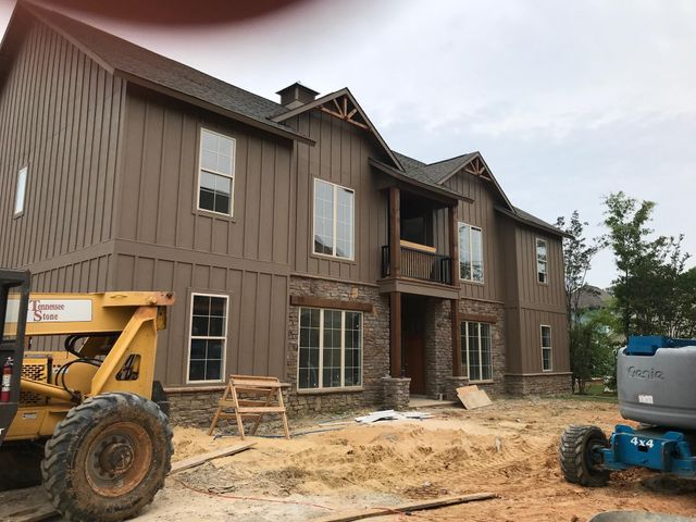 From the driveway, this building will be on your left as you walk into the courtyard. Unit 106 will be at the top right.