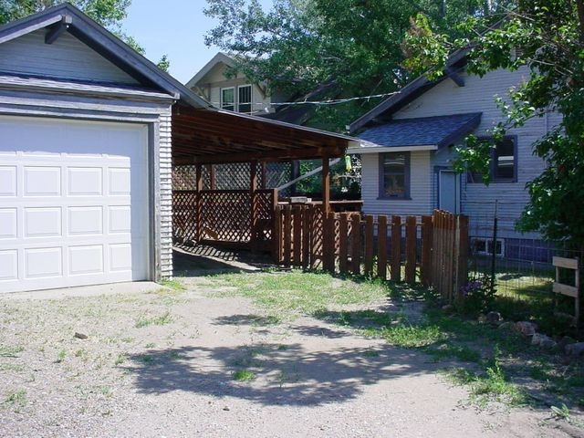 BACK YARD INCLUDES SINGLE GARAGE WITH CARPORT