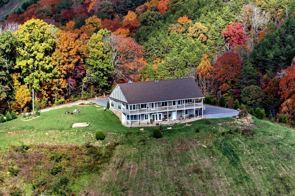 Exquisite, charming & spacious are just a few words to describe this remarkable 4 BR, 4.5 BA home.  Panoramic views, upscale home, high atop a hill minutes from Sevierville.   Each BR w/full BA, 2 kitchen areas, full basement could be in-law quarters complete w/KIT, LR, BR & BA. Great over-sized garage w/custom cabinets for storage. Formerly used as a Bed and Breakfast, home is ready for a family that can appreciate everything that comes with such a fine piece of property right here in the backyard of the Great Smoky Mountains.  1-Yr. Globe Home Warranty.   (Total square footage, per Tax Office, and includes approximately 800 sq. ft. semi-finished [heat/cooled/sheet rock] garage.)