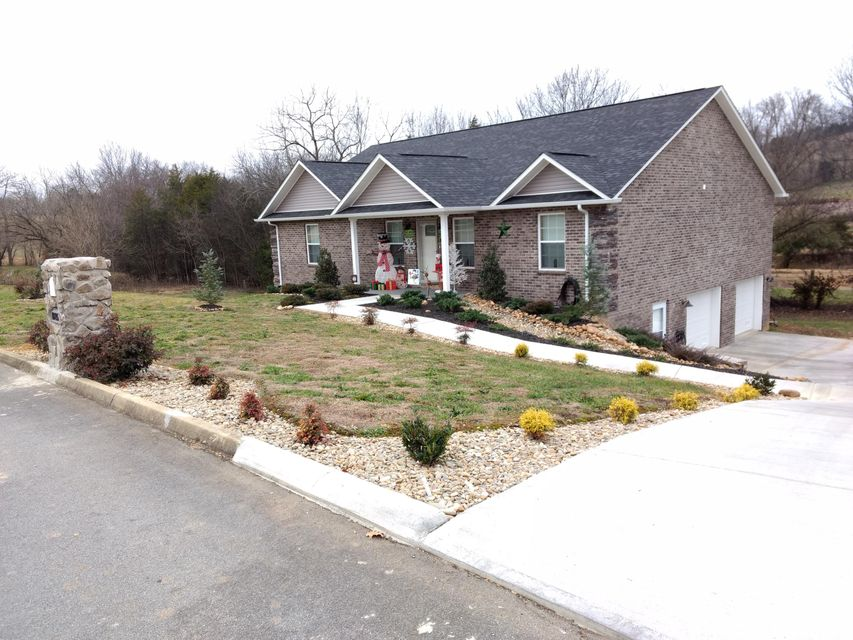 At the foothills of the Great Smoky Mountains, this February 2017-built home in Sevierville is a must see. 3BR/2BA with full-basement with two unfinished rooms and a 2-car garage (Yes, guys your four-door truck will fit).  Granite tops in kitchens and baths.  Convenience: 5-mins to DollyWood and downtown Sevierville. Only 15 mins to Gatlinburg! Wonderful neighborhood. All brick. Price to sell at below tax appraisal. Come make this home in the country and by the mountains yours.