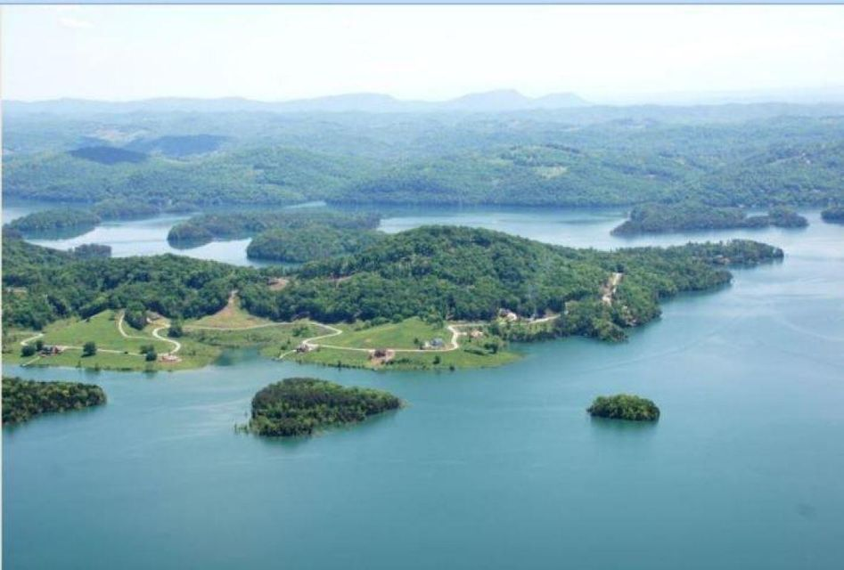 Level and dockable lakefront lot with deep year round water, surrounded by Norris Lake and the Chuck Swan Wildlife Management Area,(a 25,000 acre wildlife preserve protected by TVA that will never be sold or built upon), and located less than 45 minutes away from Knoxville. The 1,000 acre Norris Lake community of Sunset Bay offers a helipad, private marina, underground utilities, clubhouse, tennis court, and pool. Sunset Bay was developed away from city lights for an unspoiled sky perfect for stargazing and breathtaking sunsets. https://www.youtube.com/watch?v=molK1wuHPQA