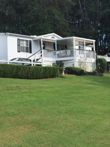 Great well kept home!! Wonderful front and side deck! 2 storage sheds!! Close to the Smoky Mountains and Knoxville! You must come and see this cute home!