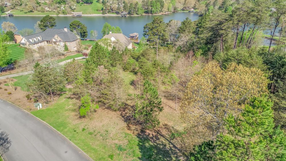 2.82 LAKEFRONT acres in the highly desirable CONKINNON POINTE subdivision.  Build your dream home on these level to gently sloped lots. Year round deep water. Ground maintenance is taken care of for you by the HOA. What are you waiting for? Summertime and boating season is just around the corner.
