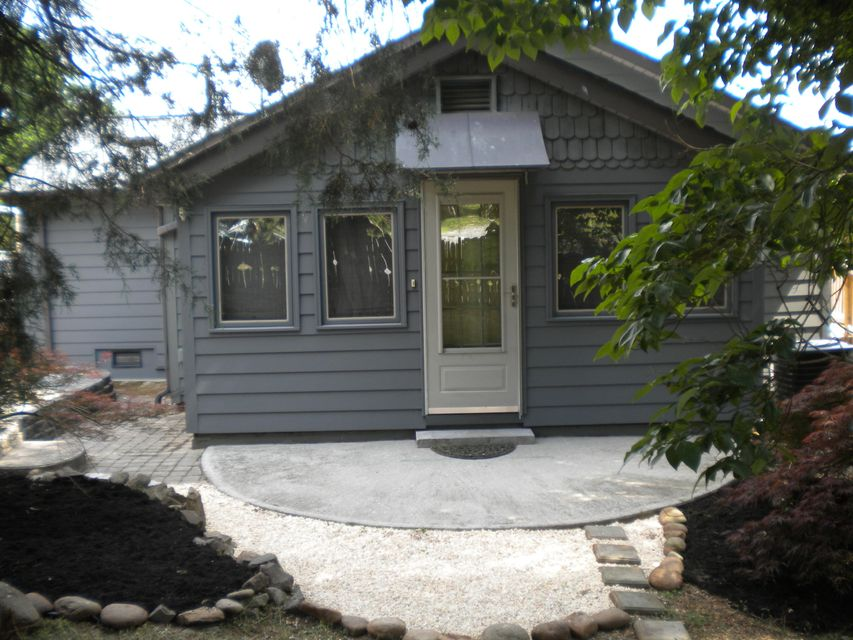 MULTIPLE OFFERS. HIGHEST & BEST DUE BY 5:00 PM 6/1/2018!!! New roof, siding, HVAC, hot water heater, updated plumbing & electric, new cabinets, counter-tops, fresh paint inside & out. New stainless appliances, washer/dryer connections on main & in the basement, refinished hardwoods. Enjoy lots of natural light in the Sunroom. Small loft in the living room adds visual appeal. A large basement with utility sink & tons of storage space. Separate workshop space for special projects & detached shed for lawn care storage & more. Patios & huge multi level decks for entertaining. A large concrete pad for pool or Jacuzzi with drainage. Double lot with beautiful  mature trees for privacy & plenty of space for outdoor activities.Conveniently located in Bearden close to Kingston PK.