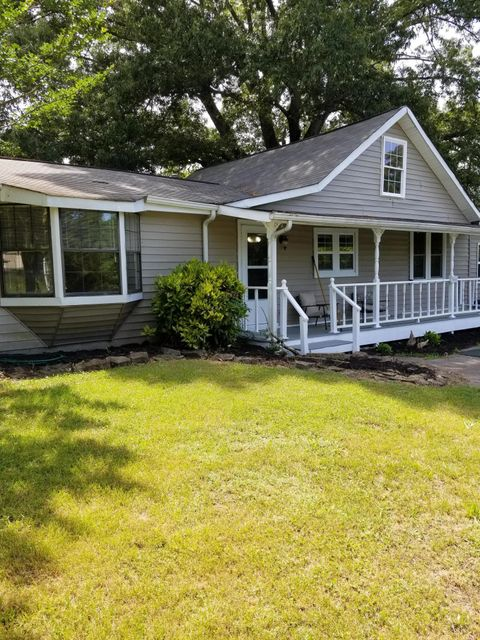 2.5 acres in the heart of Louisville which boast a Barn w/ 2 stalls, electric & water. Covered porches on the front & side w/deck between house & apartment. Roof new in 2011, HVAC & ductwork 2015, siding in 2012,  freshly painted & Newer windows.  There is a 1 BR 1 BA 576 sf separate full functioning apartment for your college student or elderly parent. The lot allows for a large garden in the lower field & your horses in the fenced upper field. There are peach, pear & apple trees and grape vines. Come see and make an offer! Sold AS-IS!! Seller to do no repairs. Only 203K FHA financing, Cash or Conventional. Well has new submersible pump. Fire pit behind apartment. Mountain view in upper field. Sun porch off living room.