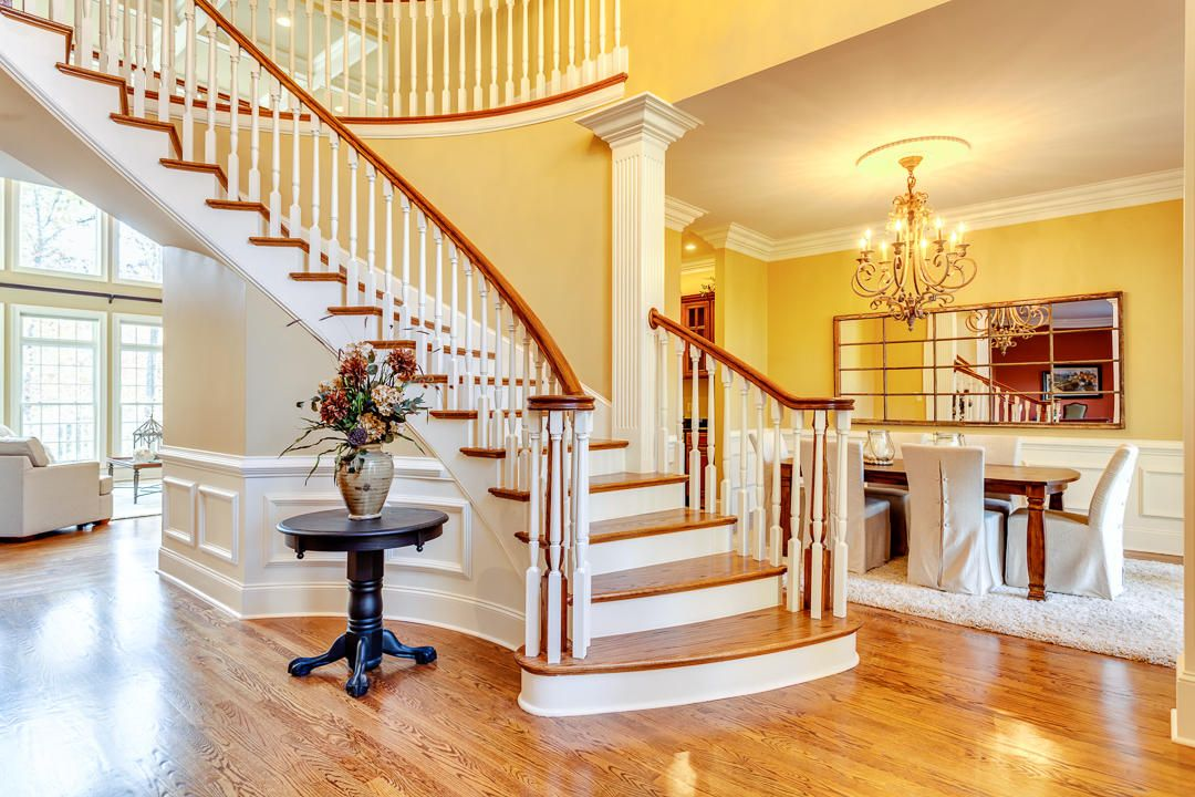 Sweeping Staircase to Second Floor