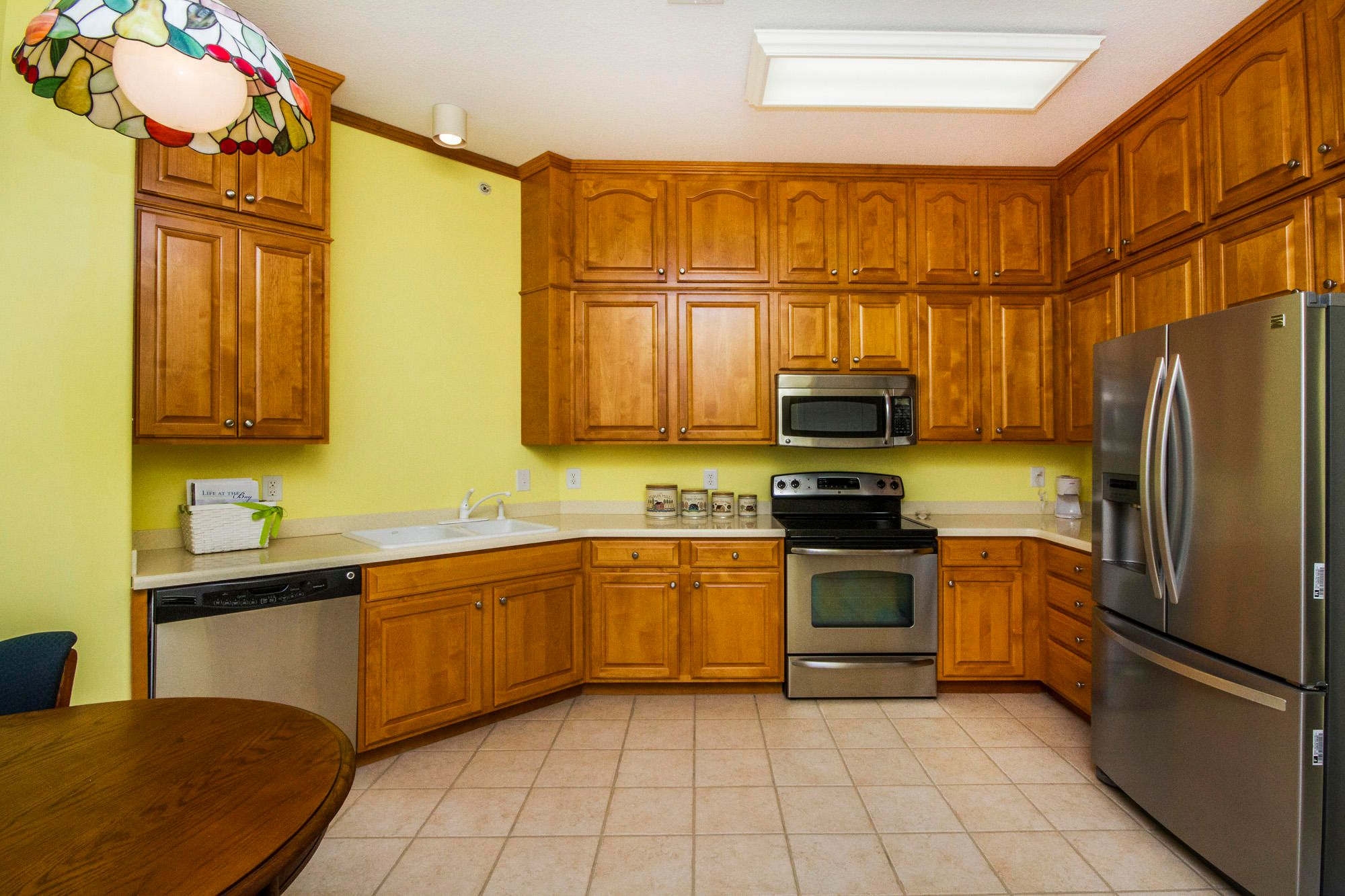 Tall Maple Cabinetry & Corian!