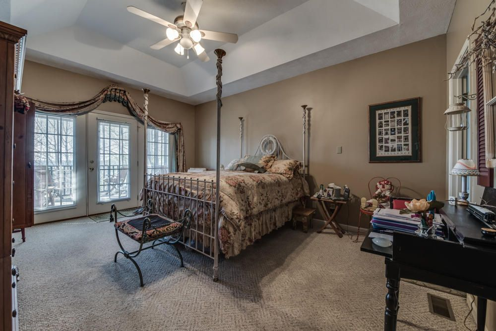 Master bedroom leads to screened porch