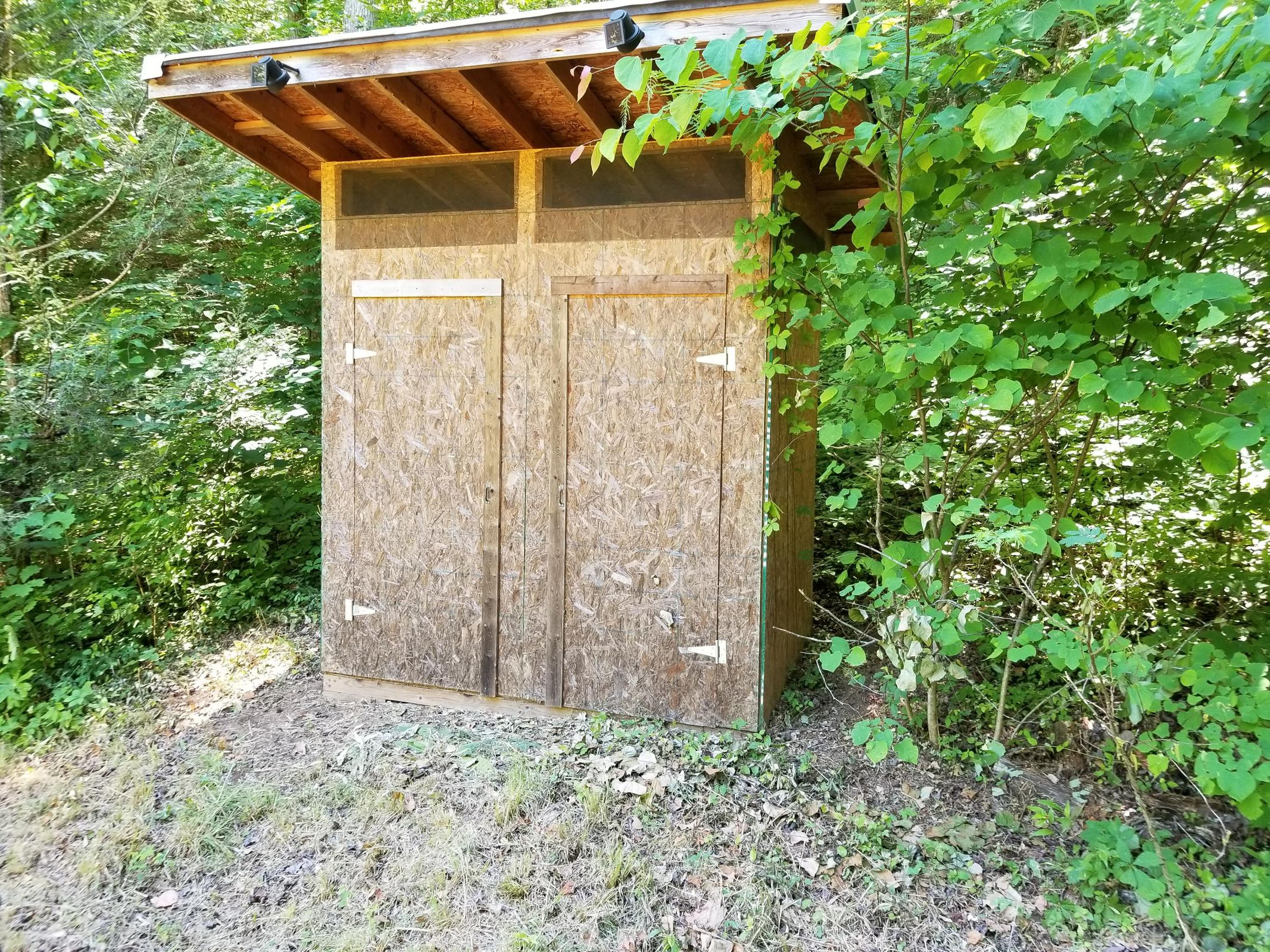 His and Her Outhouse