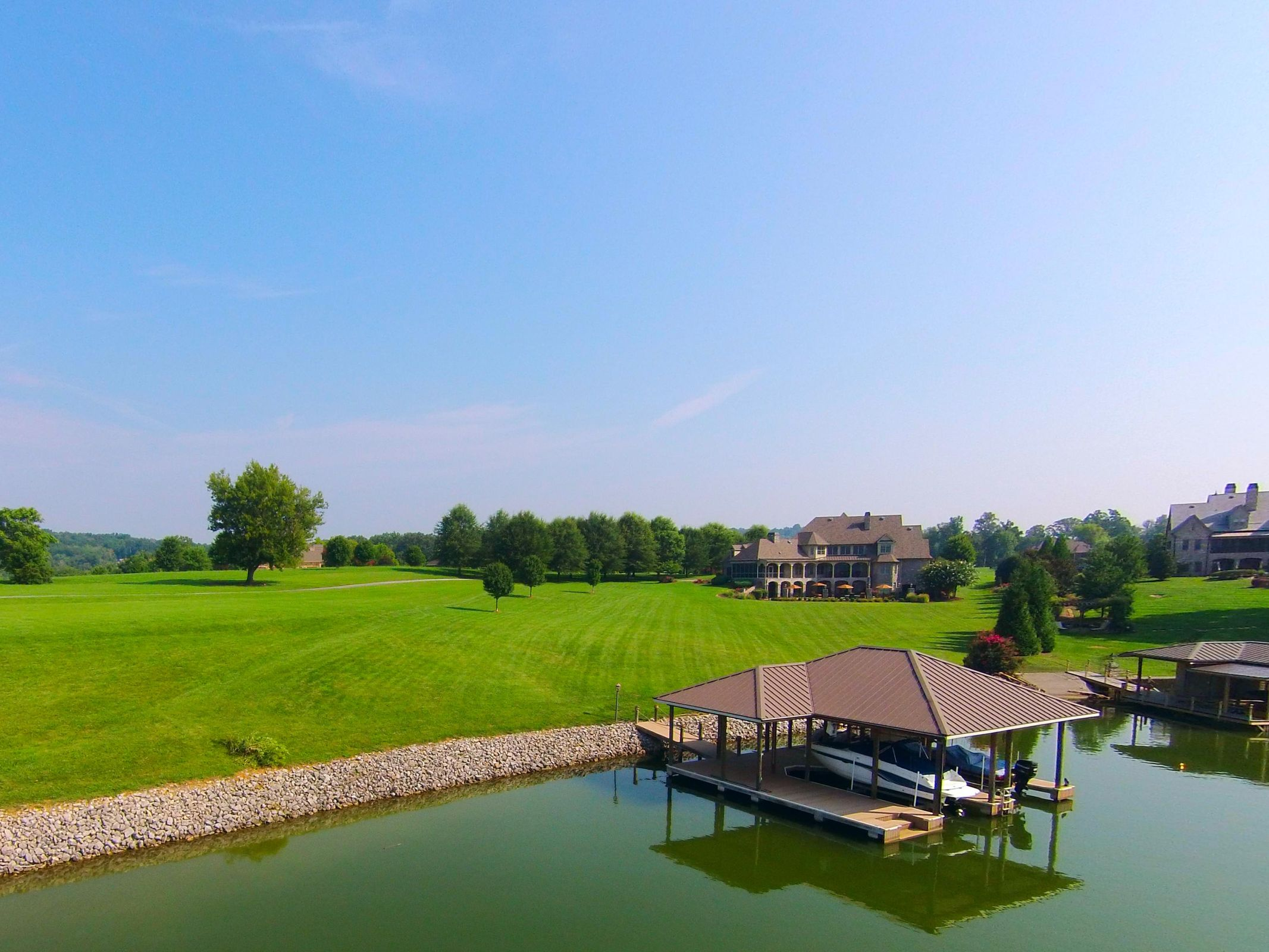 Estate from Lake with Boat Dock