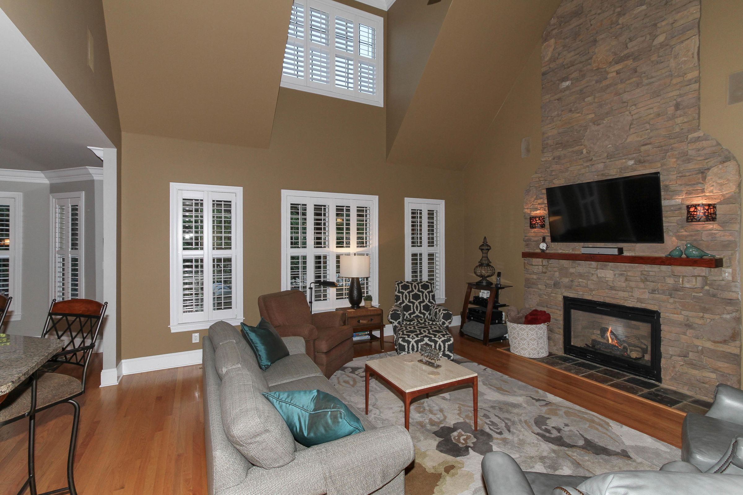 08 - Vaulted Great Room with Stone Firep
