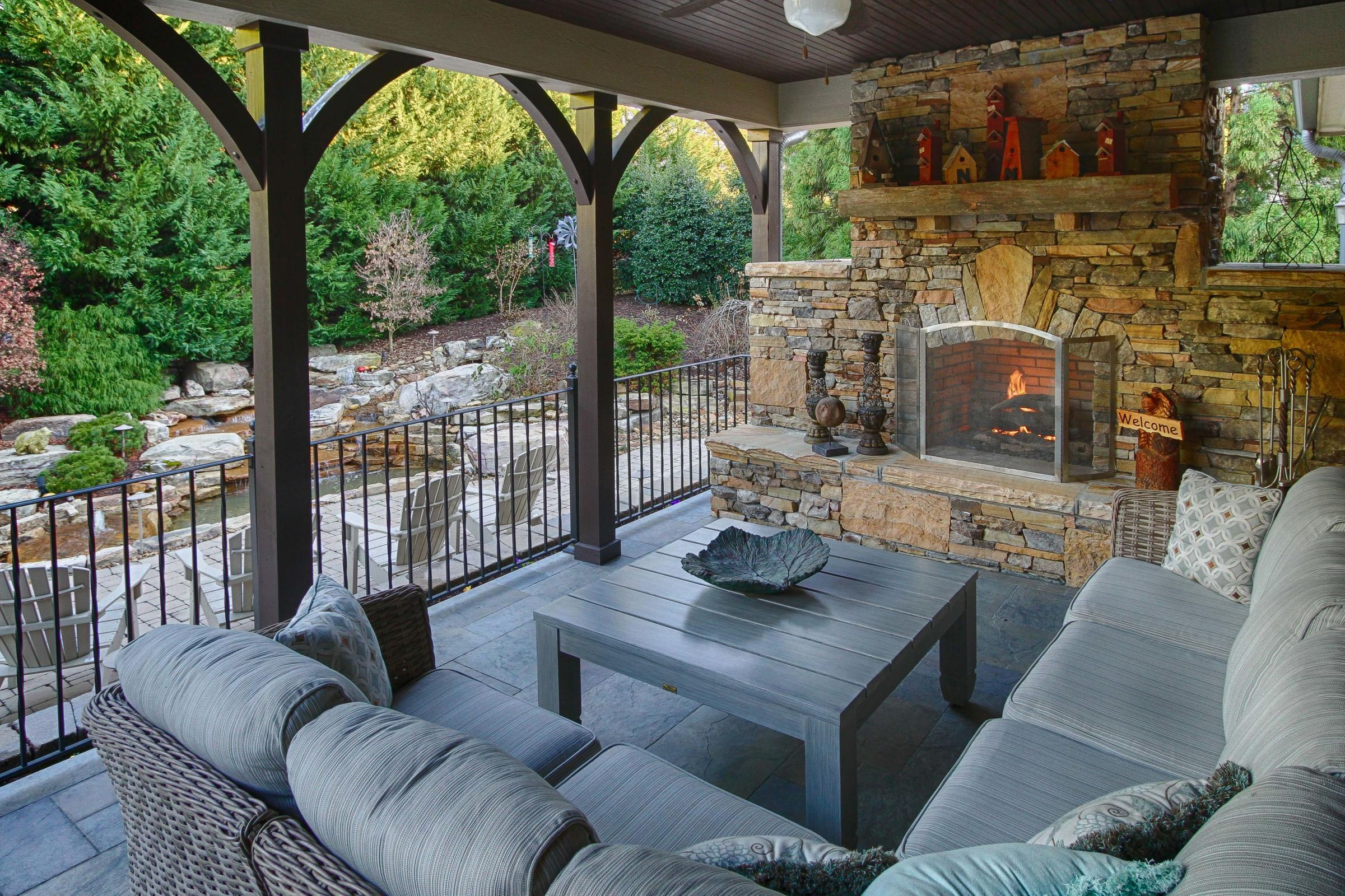 28 - Covered Rear Porch with Fireplace