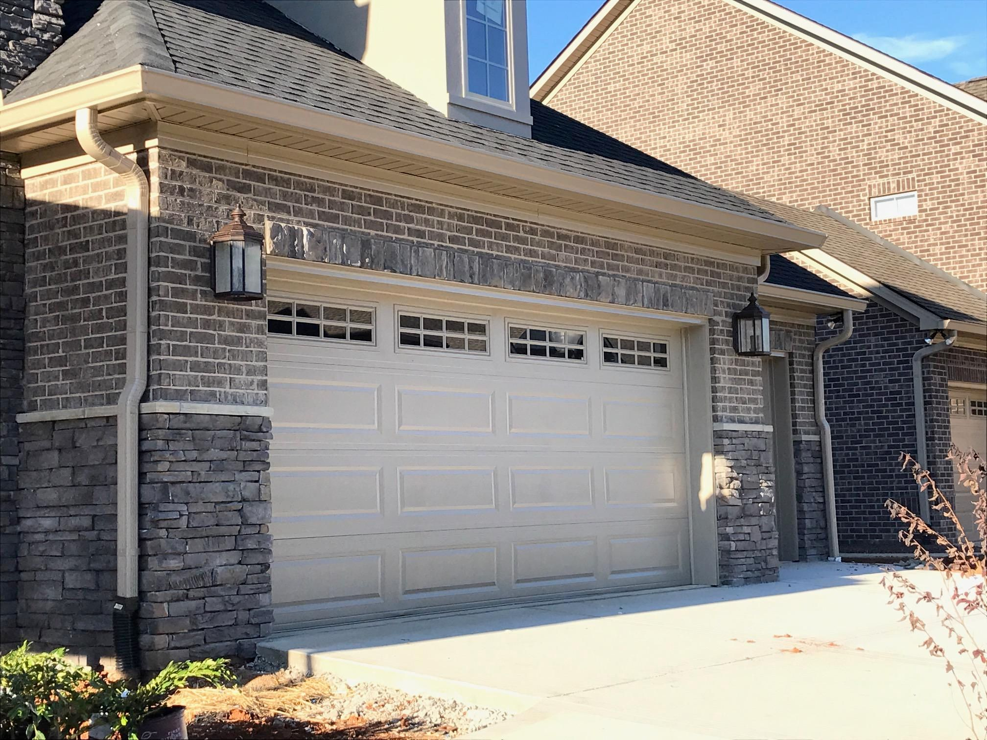 Carriage lights accent garage entry
