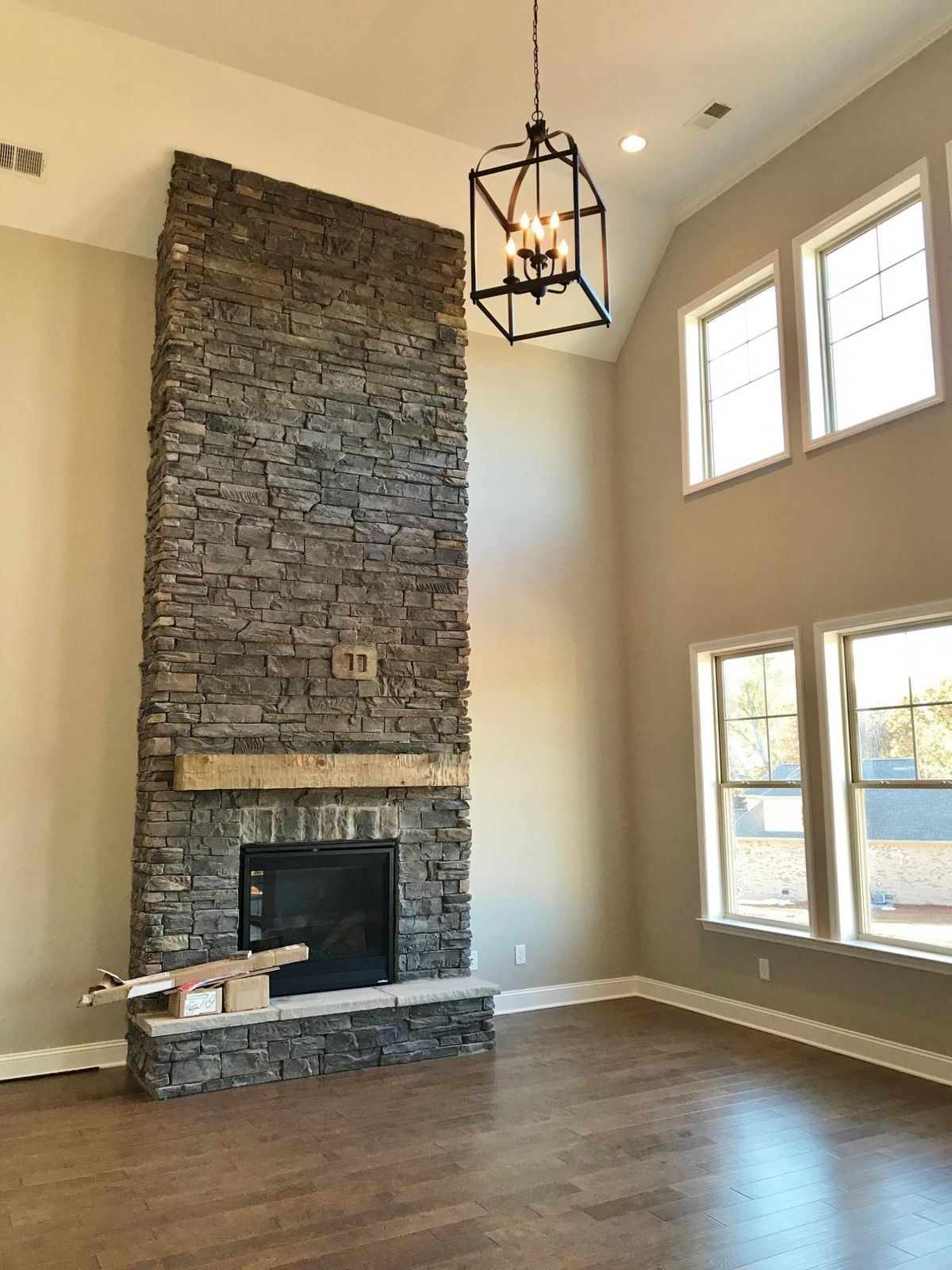 Two story stack stone fireplace
