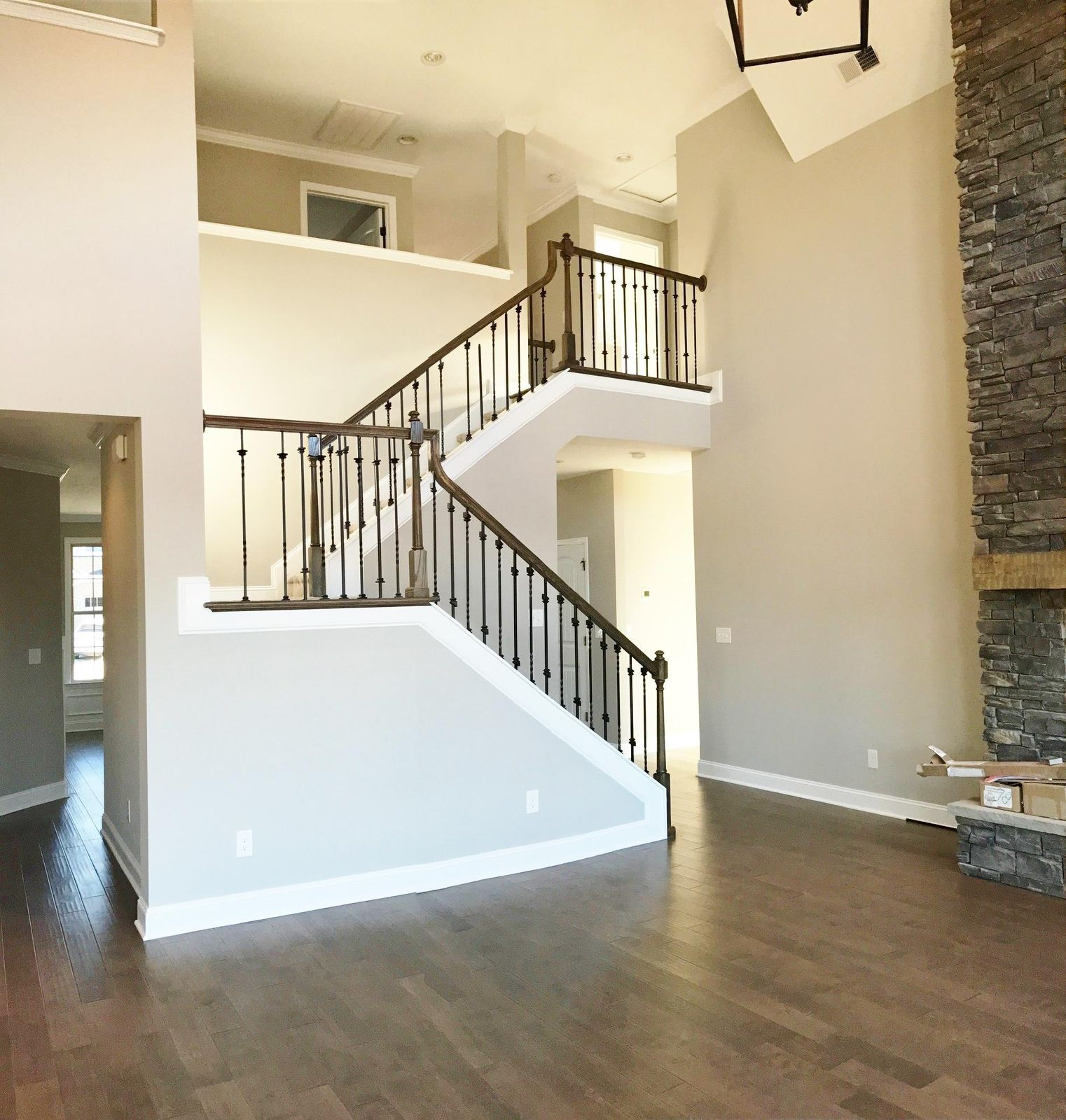 Open railing on stairs to second floor