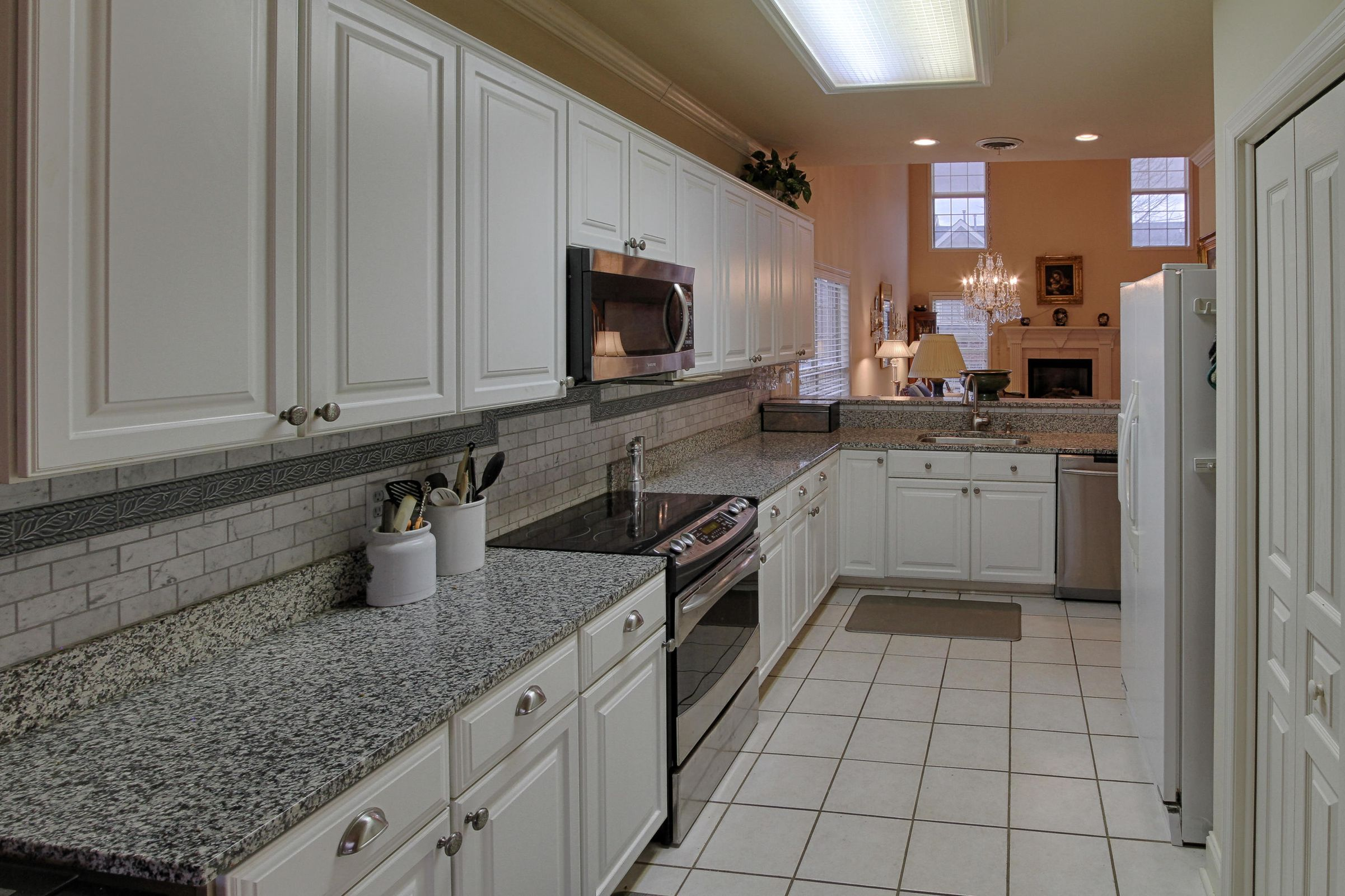 06 - Lovely kitchen with white cabinets