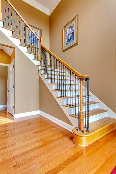 2 Story Foyer. Wood Staircase