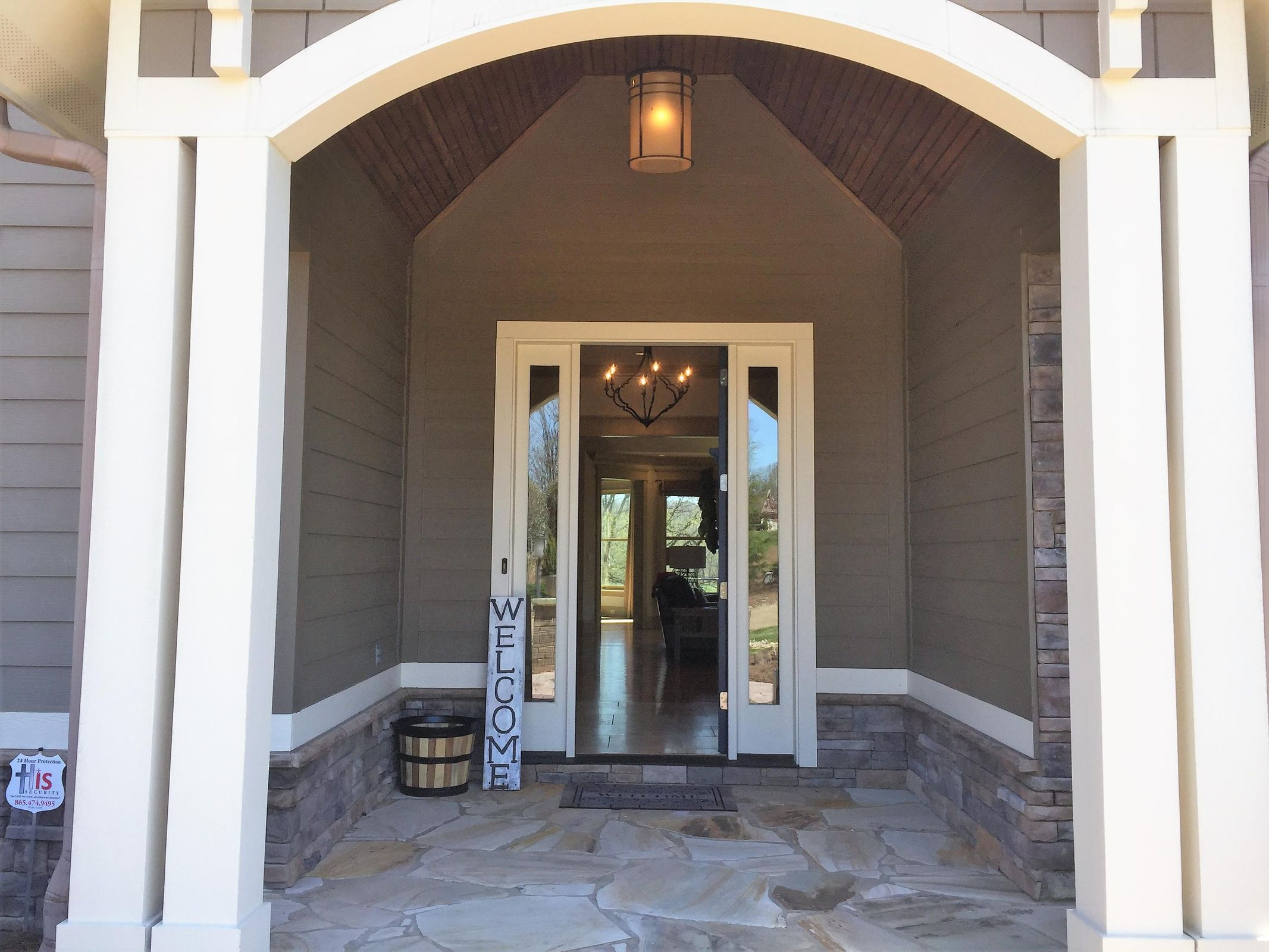 Gorgeous stone floor cover front porch
