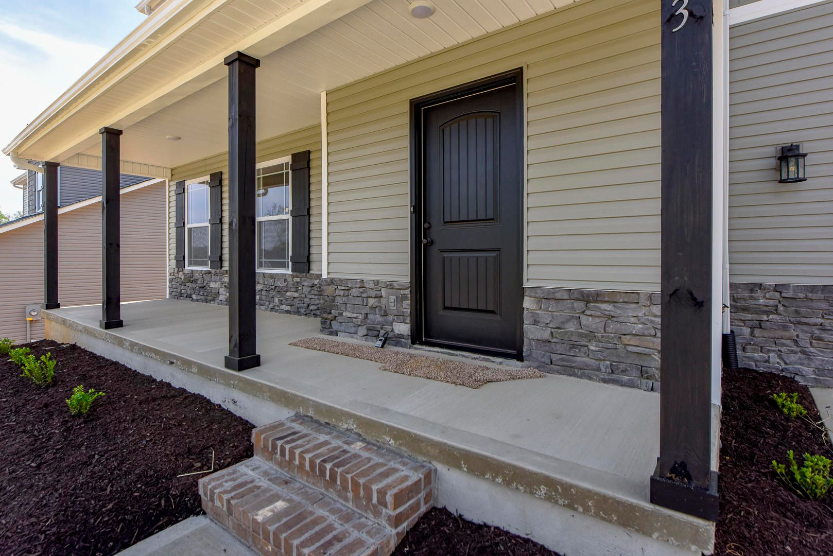 Front porch with stone accent