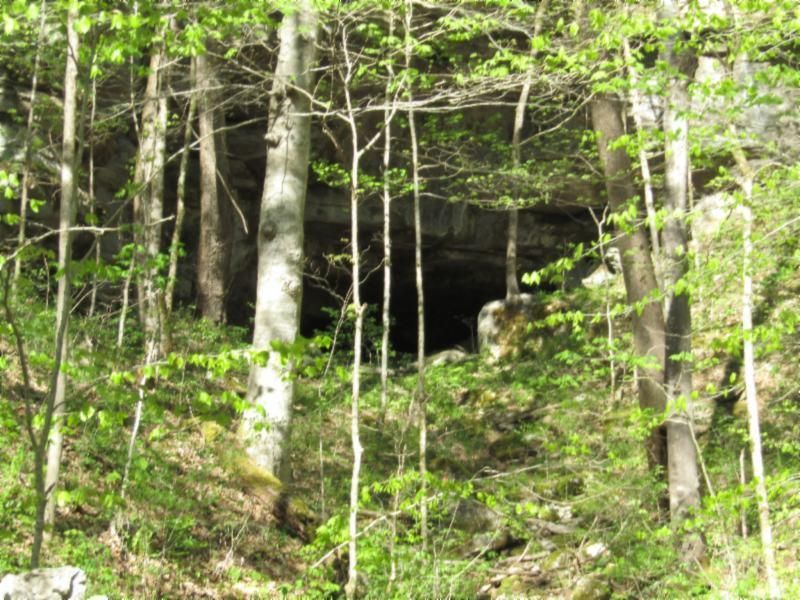 CAVE IN LAND WITH SPRING