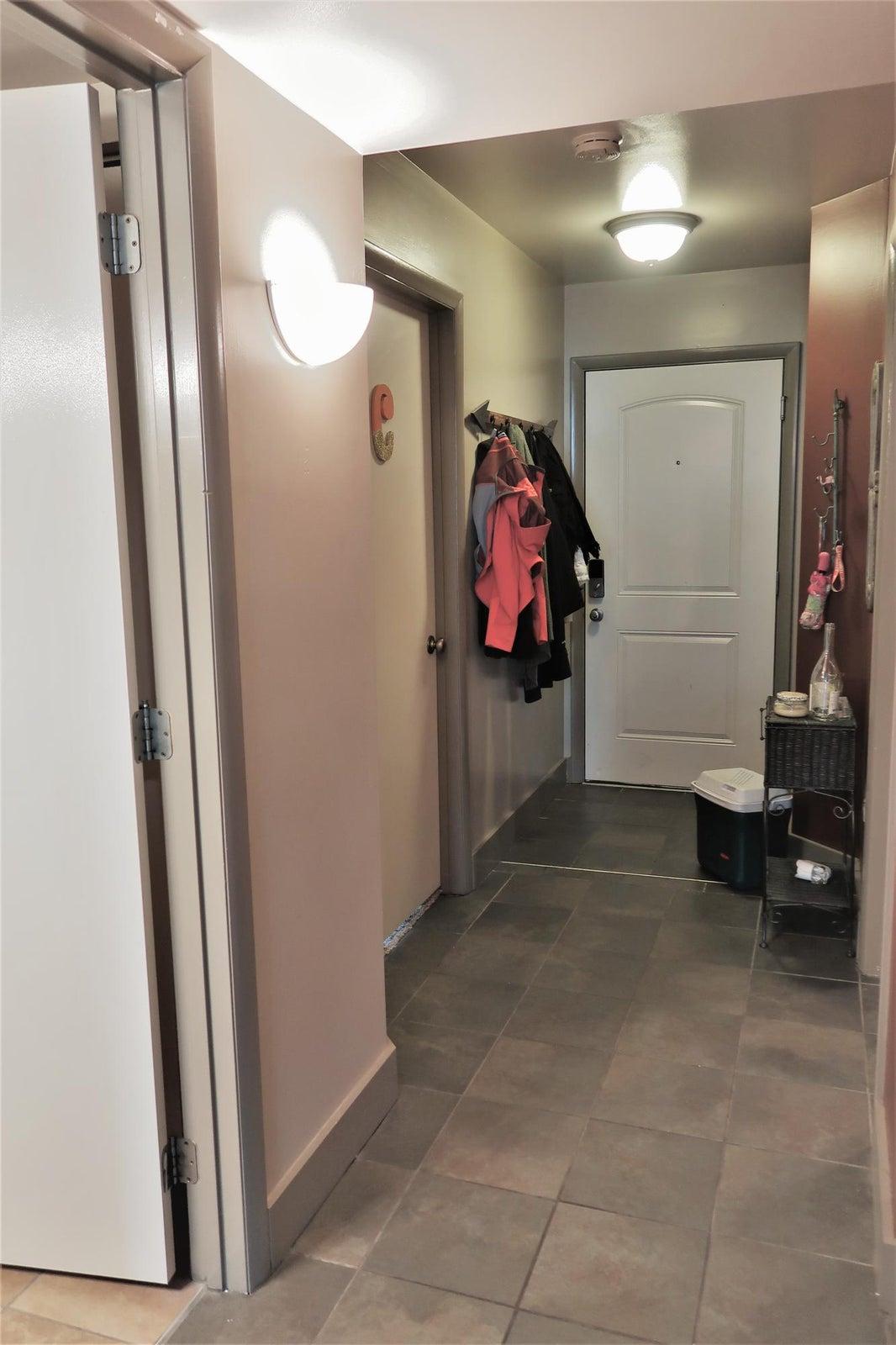 Hallway w/ tile throughout